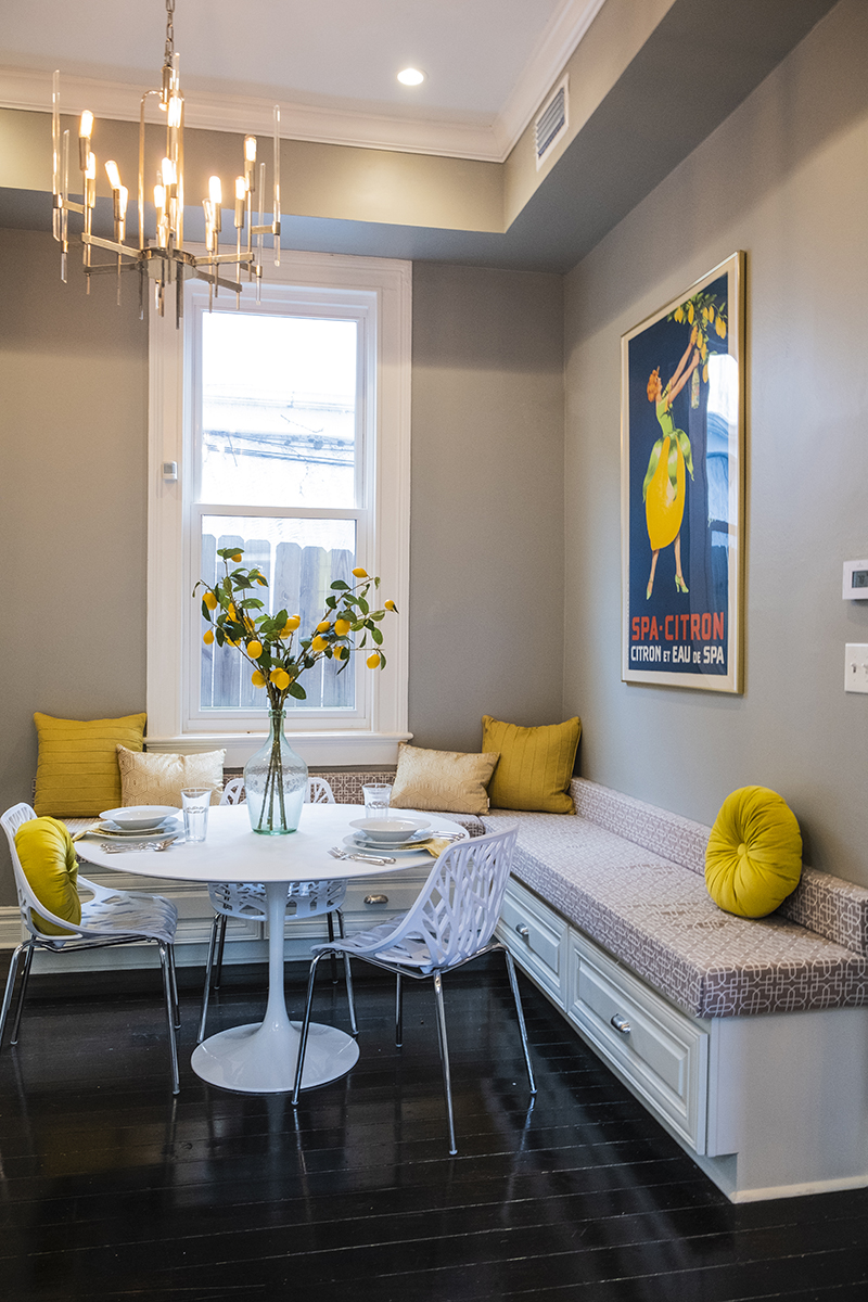 Bright and Cheery Breakfast Nook with built in storage, yellow throws, lemon centerpiece