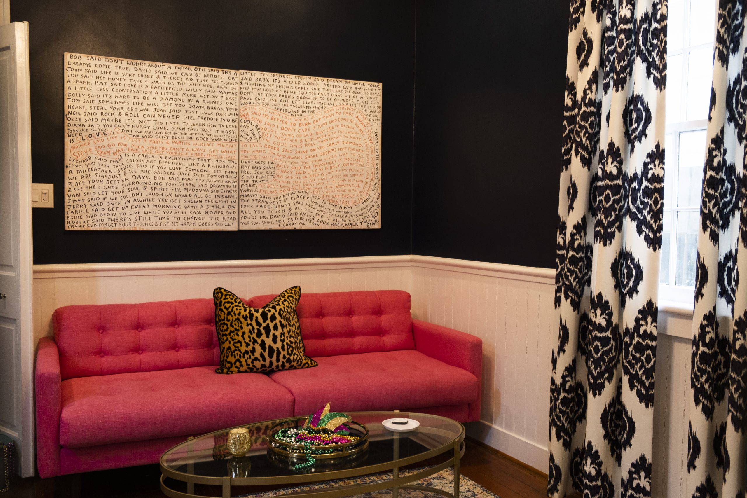 Pink Sofa with Leopard Print Pillow and Coffee Table with Mardi Gras Throws