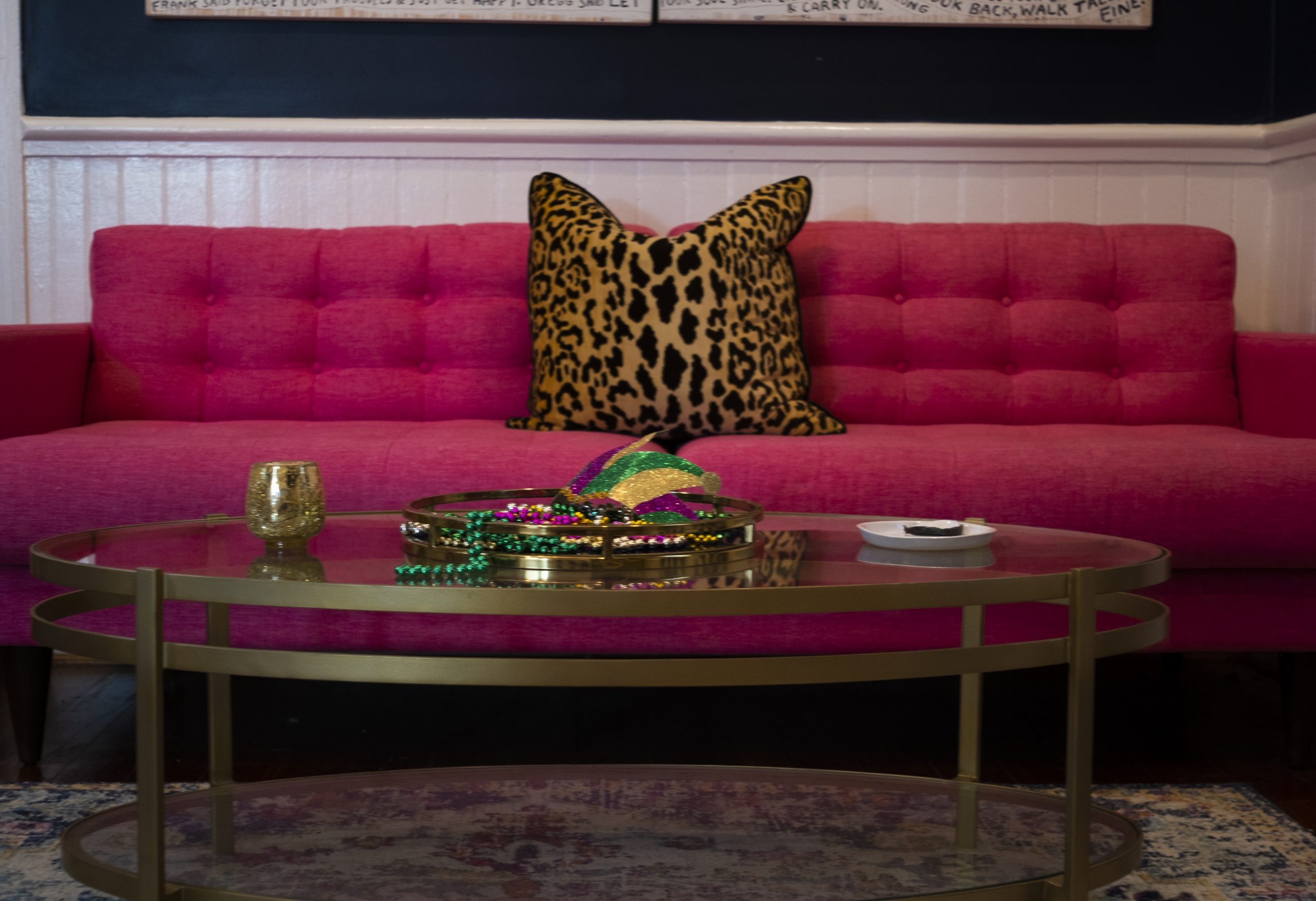 Closeup of Pink Sofa and Coffee Table with Mardi Gras Throws